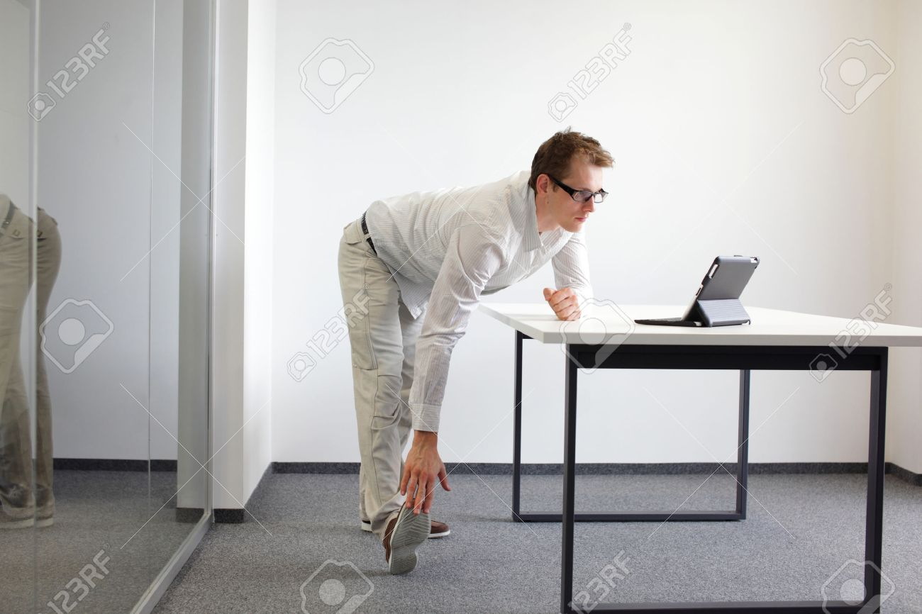 leg - arm exercise durng office work Stock Photo - 22579195
