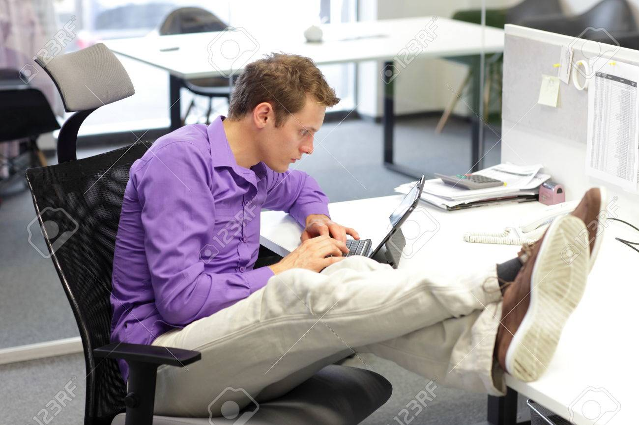 Young businessman caucasian in his office working with tablet - bad sitting posture - 25313505