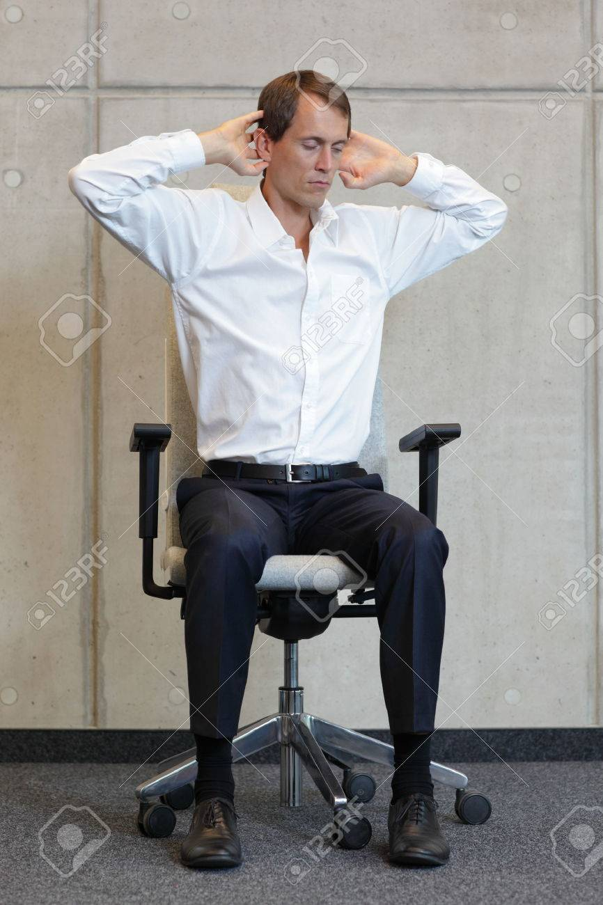business man exercising on chair - office occupational disease prevention - 33437998