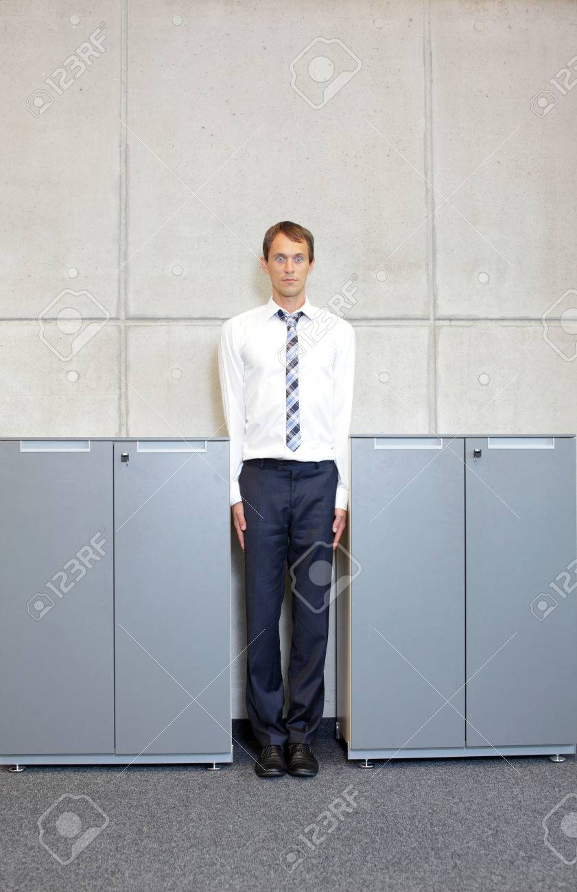 white business man standng straight between cabinets in office - concept - 36629946