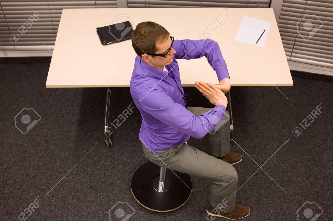 man on pneumatic stool having break for exercise in office work - 37406937