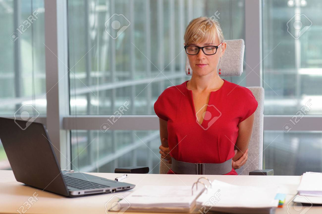 caucasian business woman in eyeglasses relaxing, stretching back - short break for exercise on chair in office - 44958175