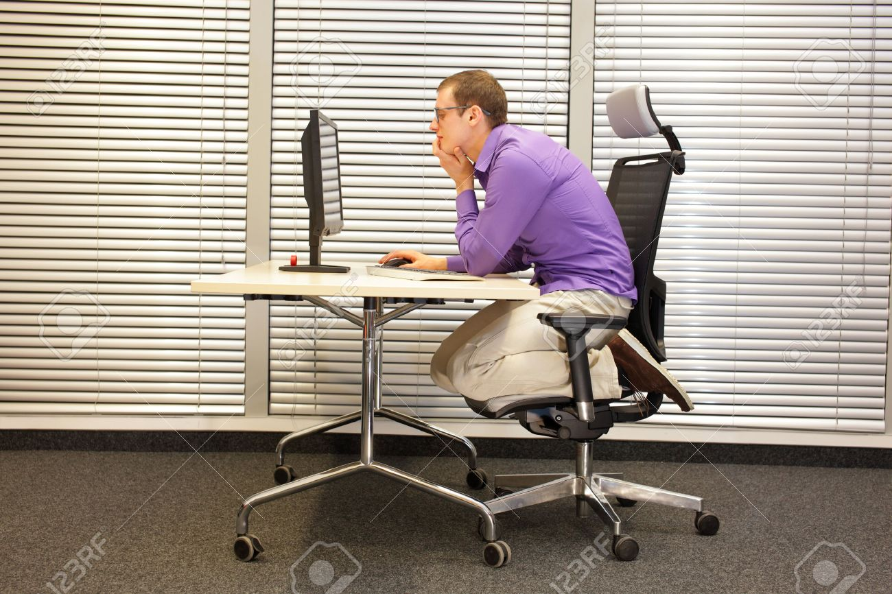 Text Neck Man In Slouching Position Kneeling On Ergonomic Chair