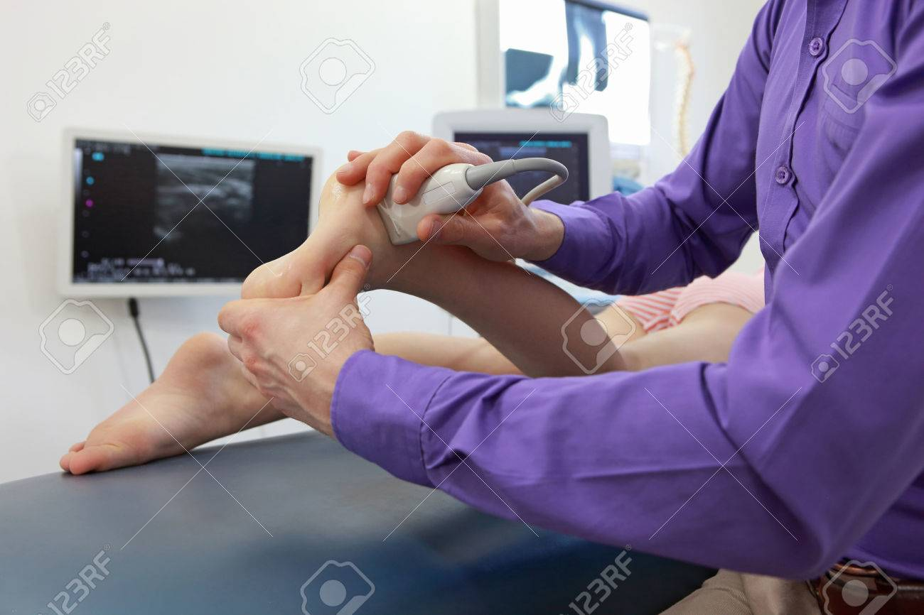 ultrasound of caucasian girl's ankle - diagnosis, close up - 73847512
