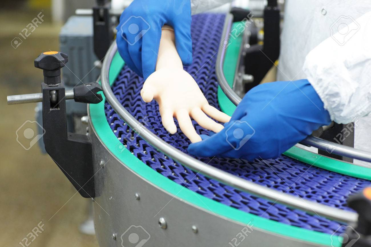 technician at conveyor belt controlling artificial bionic hand . a concept of spare body parts - 74337560