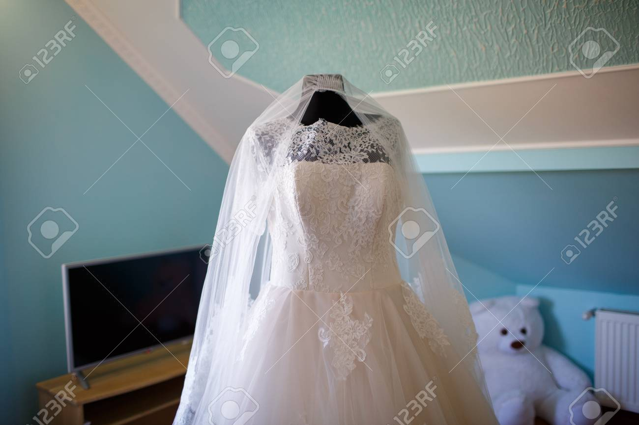 Elegant Wedding Dress With Veil The Bride In The Room Stock Photo ...
