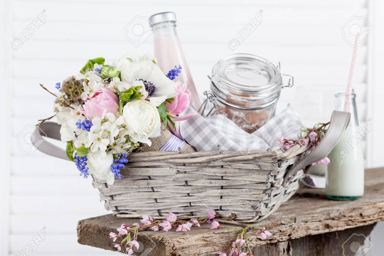 Bouquet Of Flowers With Violet Ribbon Lying In The Picnic Basket Stock Photo Picture And Royalty Free Image Image 56632792