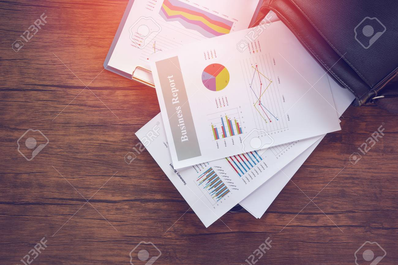 Business report chart preparing graphs on briefcase bag / Summary report in Statistics circle Pie chart on paper business document financial chart and graph on the wooden table background - 115393348
