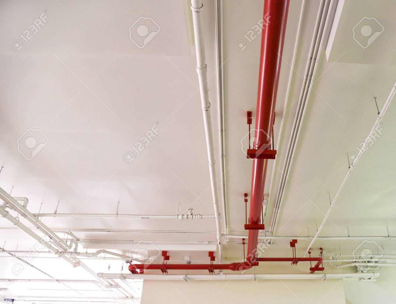 Red water pipe fire equipment / Metal water piping system install with the concrete under building - 118852319