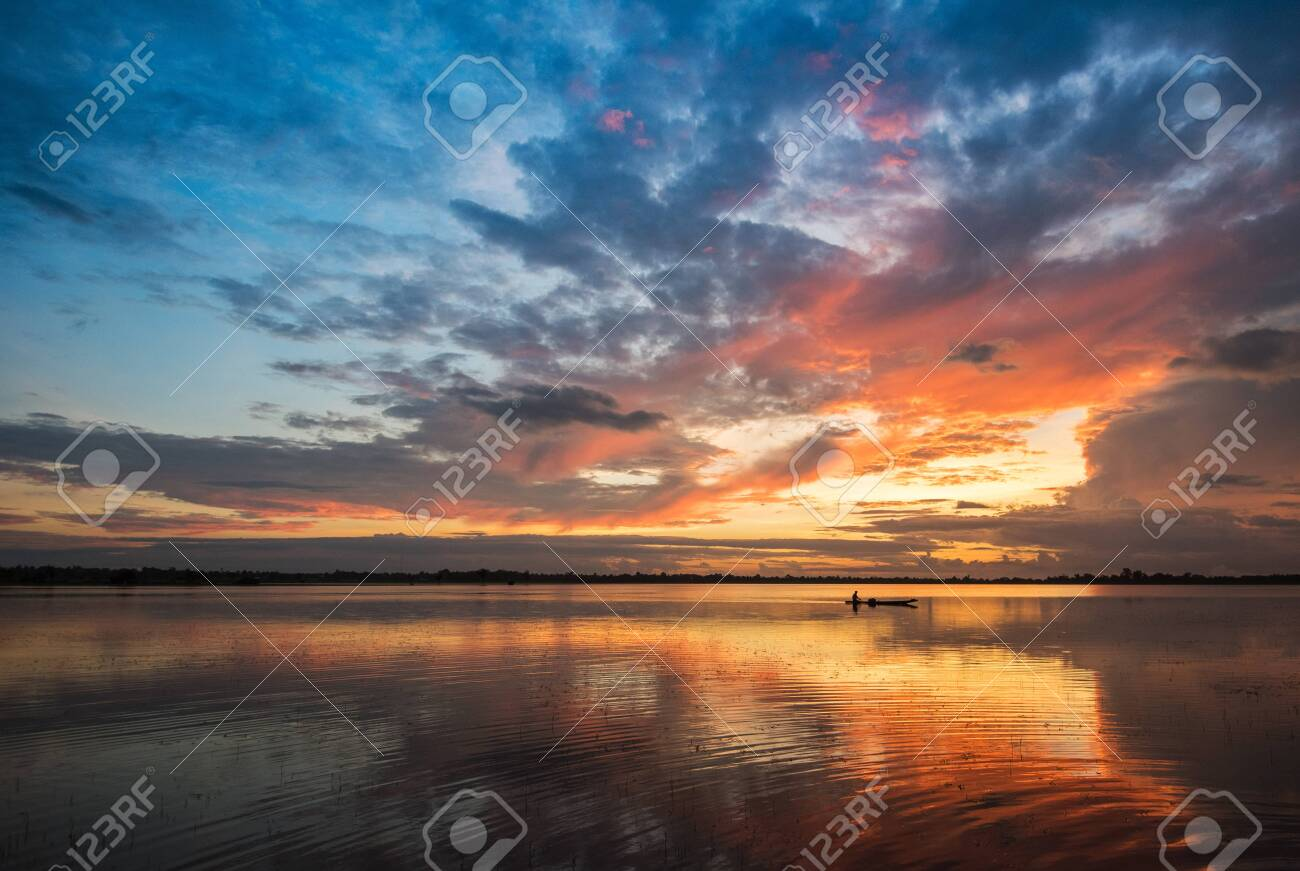 Beautiful river sky and fishing boat sunrise or sunset with colorful sky dramatic cloud background - 119252881