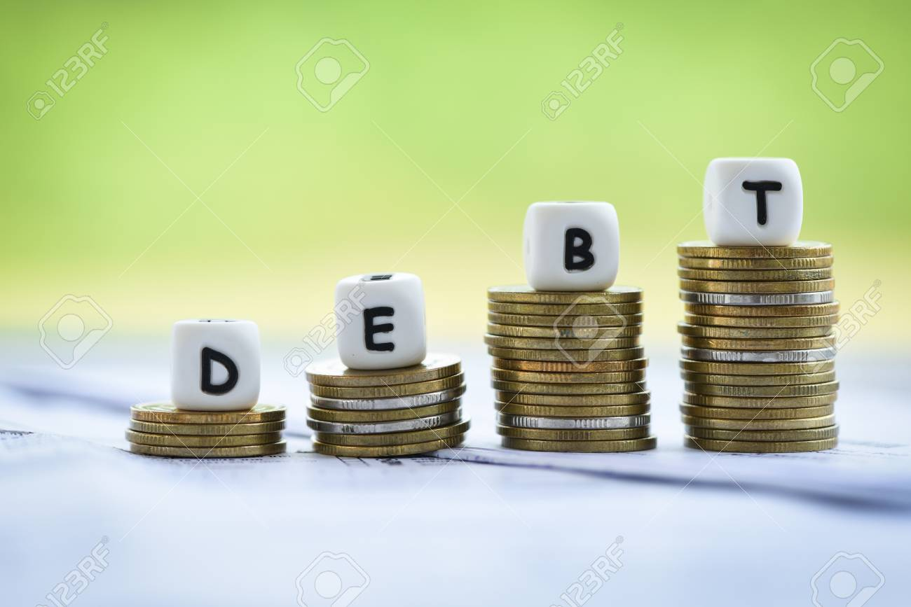 Debt dices on money coin stack staircase step up / Increased liabilities from exemption debt consolidation concept of financial crisis and problems risk business management loan interest - 122270416