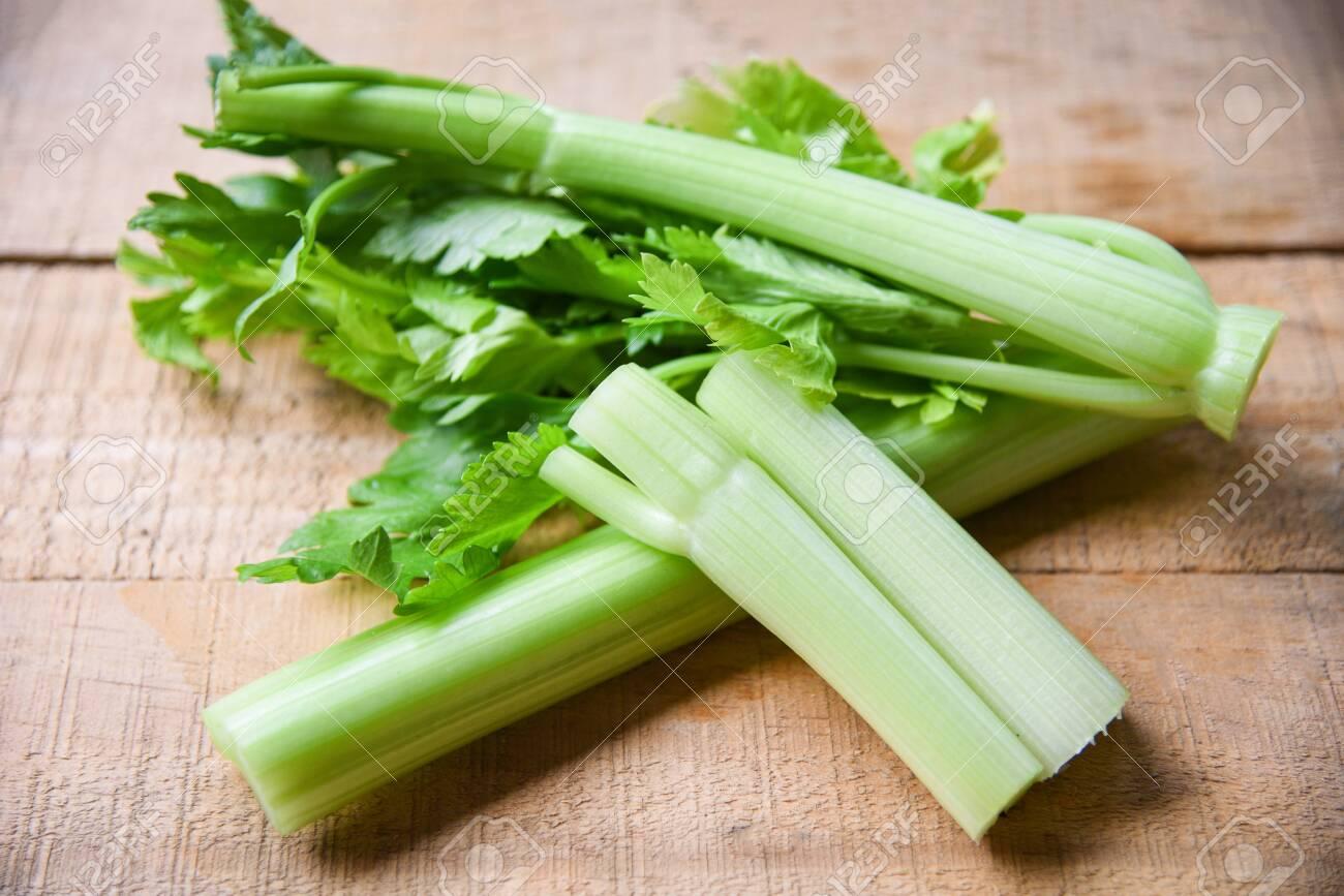 Celery sticks and leaf fresh vegetable / Bunch of celery stalk on wooden background - 124848254