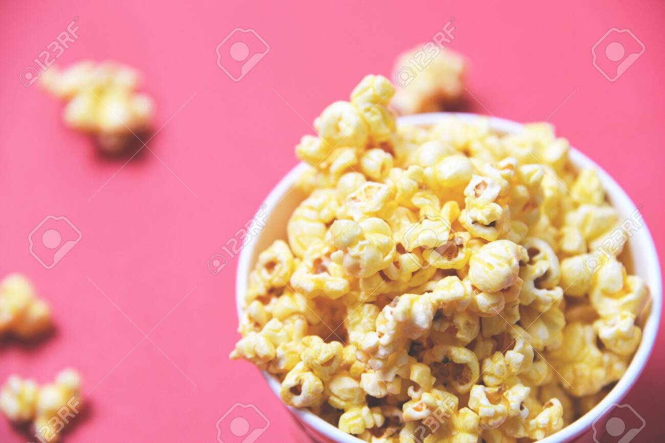 Popcorn In Cup Bowl And Red Backgroubd Top View Sweet Butter Stock Photo Picture And Royalty Free Image Image 127960626