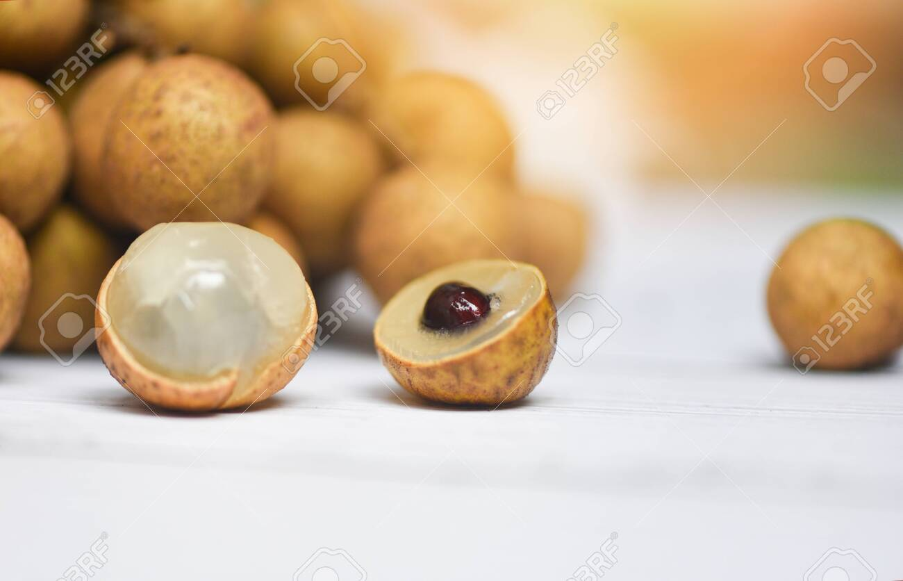 Longan fresh tropical fruit in Thailand / Close up dimocarpus longan peel exotic fruits on white plate on the table - 130174379