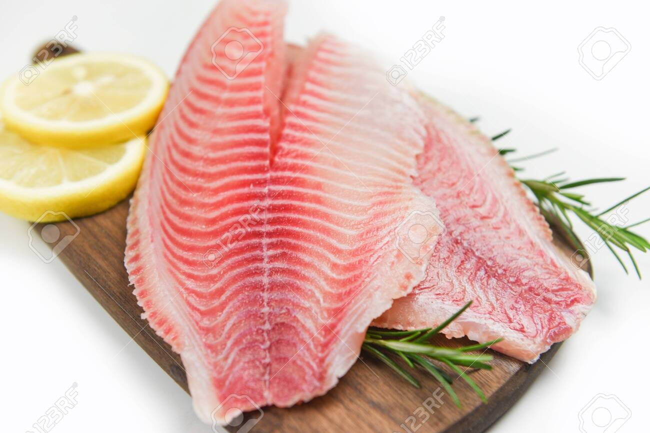 Fresh Fish Fillet Sliced For Steak Or Salad With Herbs Spices Stock Photo Picture And Royalty Free Image Image 135494107