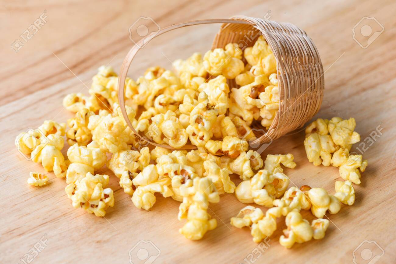 Popcorn In Wooden Basket And Wood Backgroubd Sweet Butter Popcorn Stock Photo Picture And Royalty Free Image Image 147645439