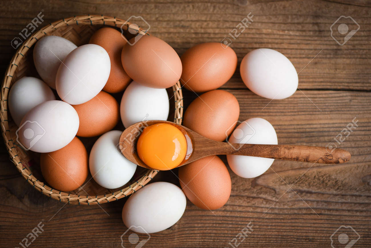 Chicken eggs and duck eggs collect from farm products natural in a basket healthy eating concept / Fresh broken egg yolk - 158657408