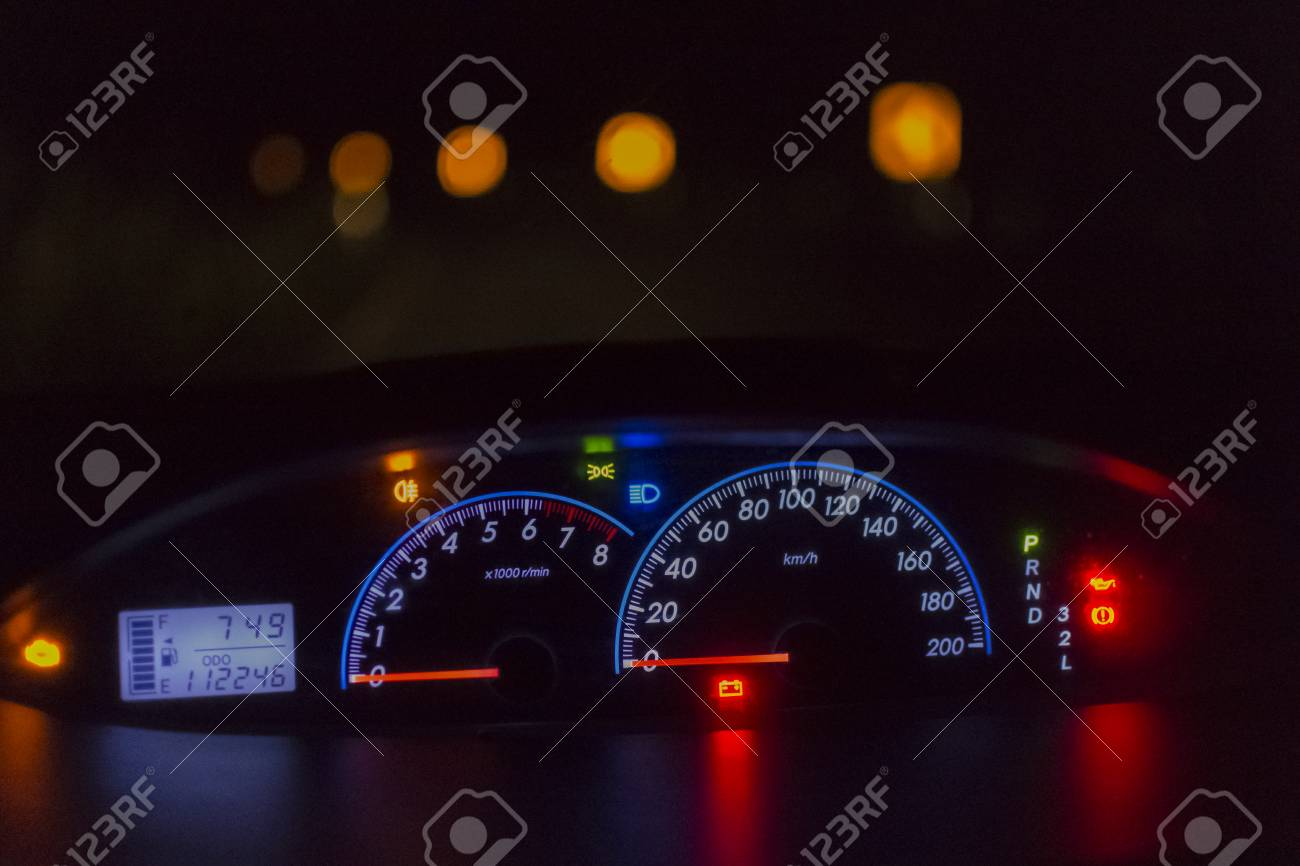 Car Dashboard Lights And Road Background In The Night.Close Up. Stock Photo