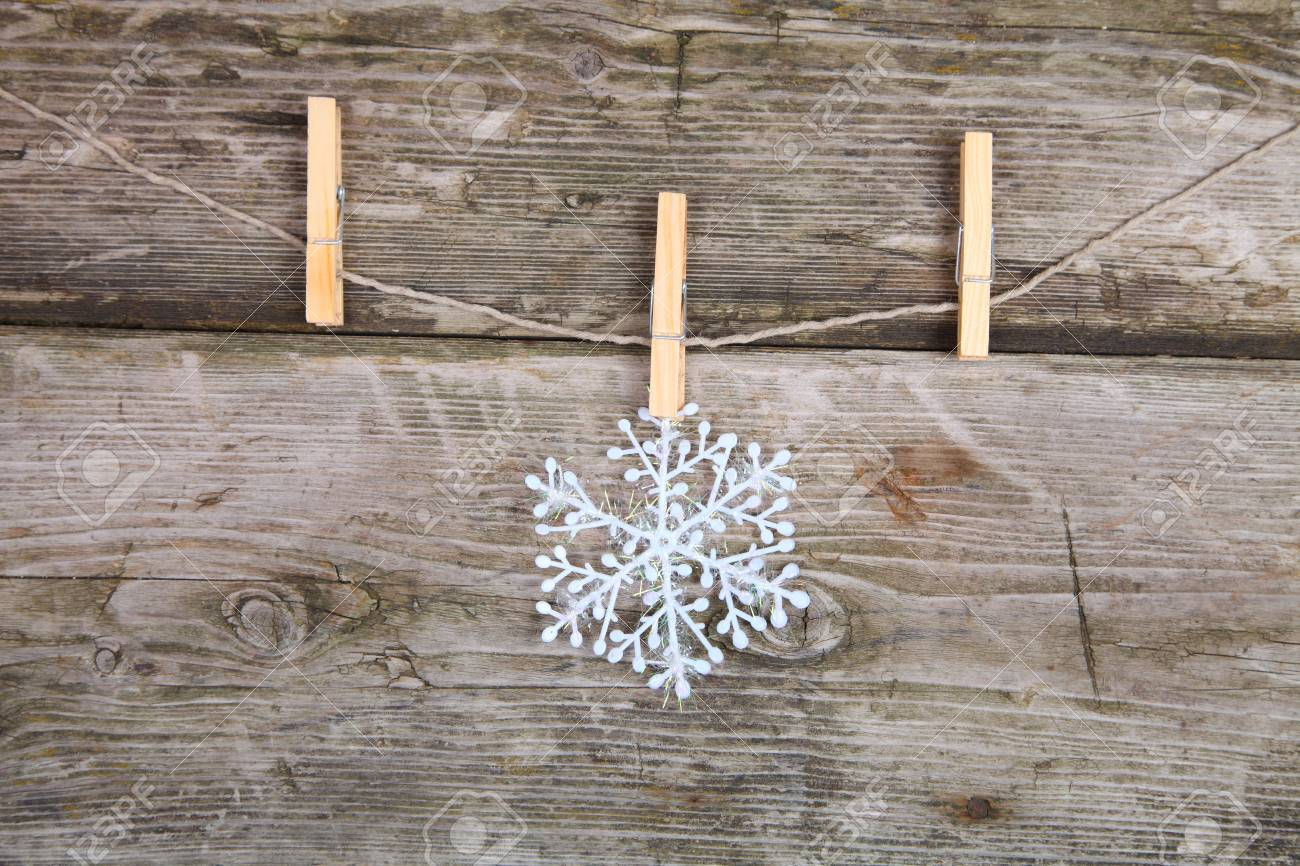 Christmas decorations (snowflake) hanging over wooden background Stock Photo - 15423839
