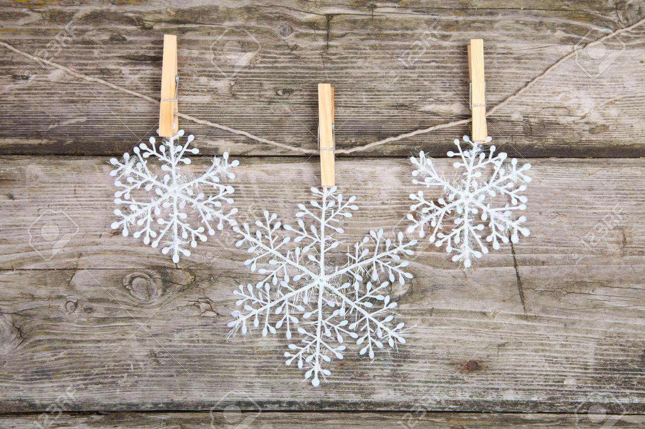Christmas Decorations, Snowflakes Hanging Over Wooden Background Stock  Photo   15629794