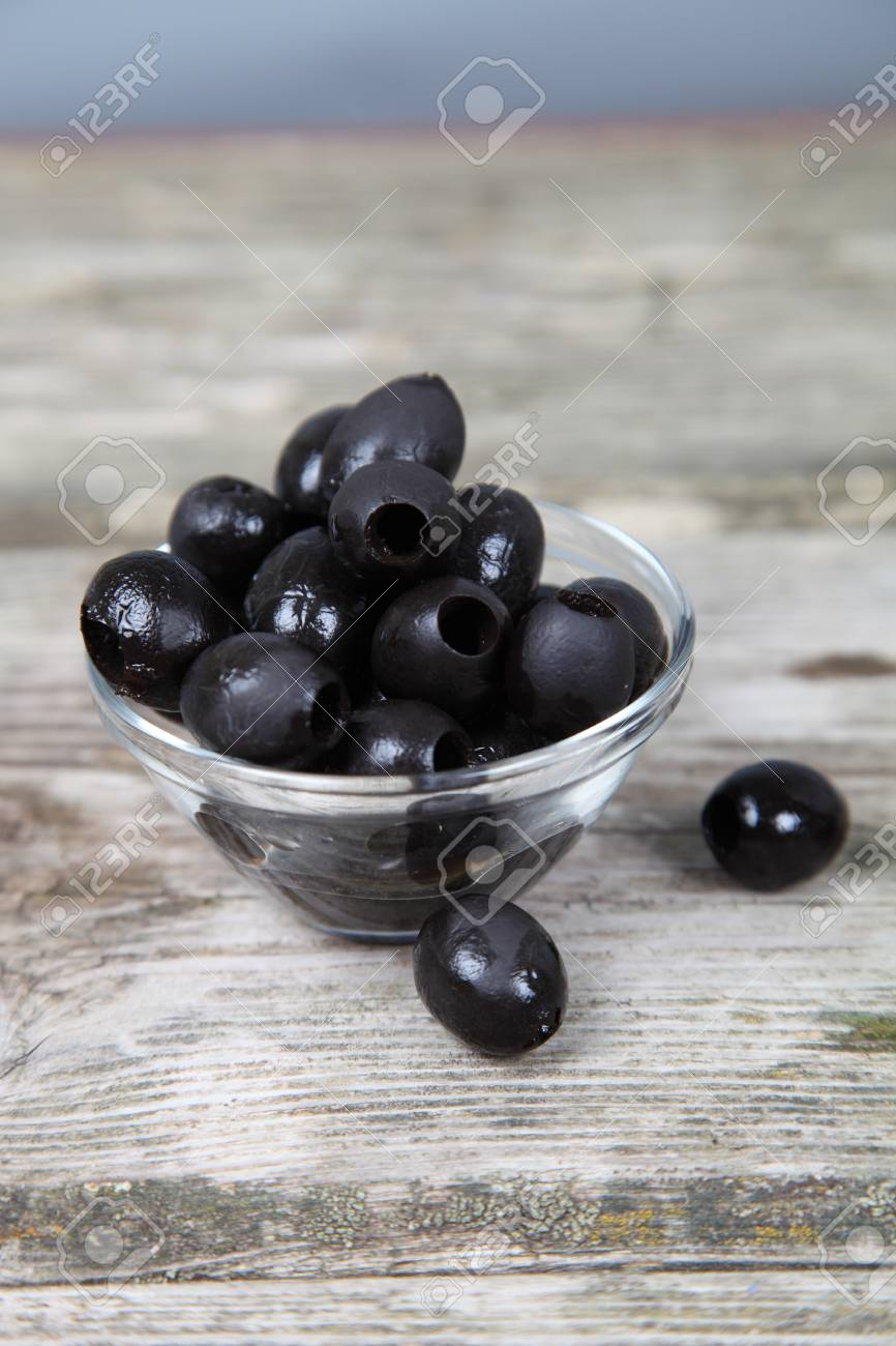 Black olives on a wooden table Stock Photo - 16920595