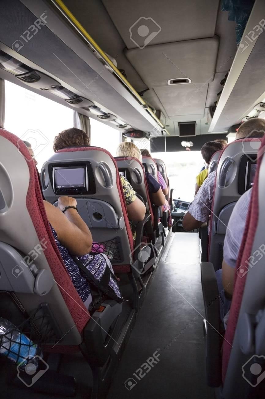 Stock Photo   Tourist Bus Interior. People Go On The Tour.