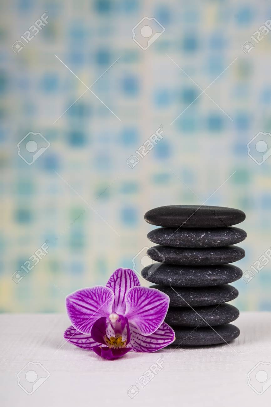 Spa Treatments In The Bathroom. Spa Stones And Orchid Close-up ...