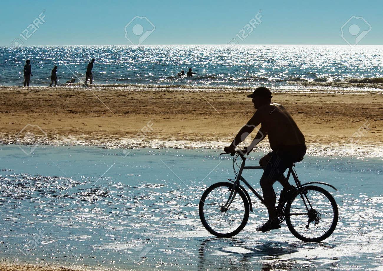 mountain biker on the beach in summer Stock Photo - 475394