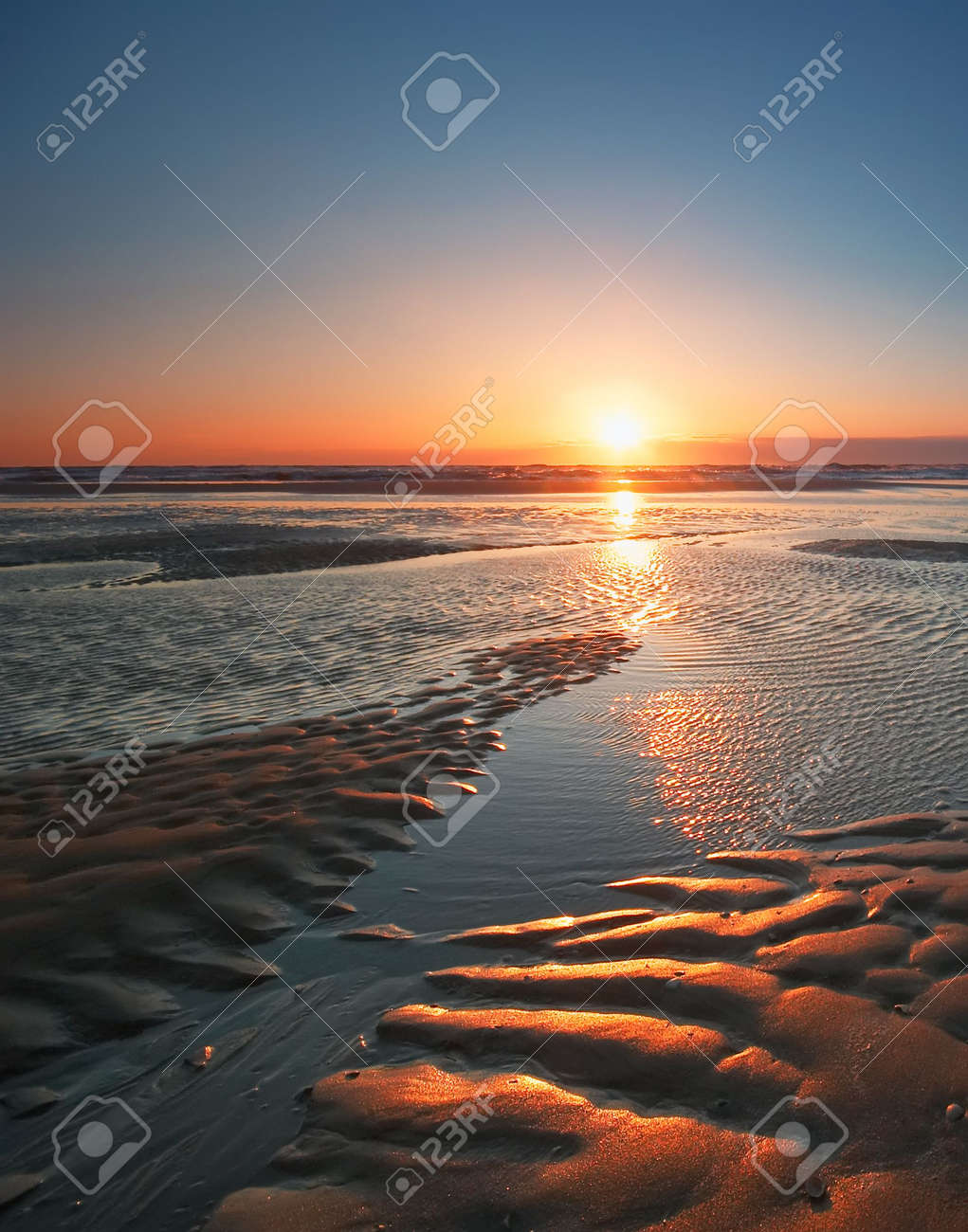 relections on the sand and  sea during sunset Stock Photo - 475340