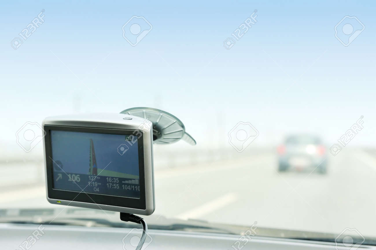 Using gps navigation on the road Standard-Bild - 5369556