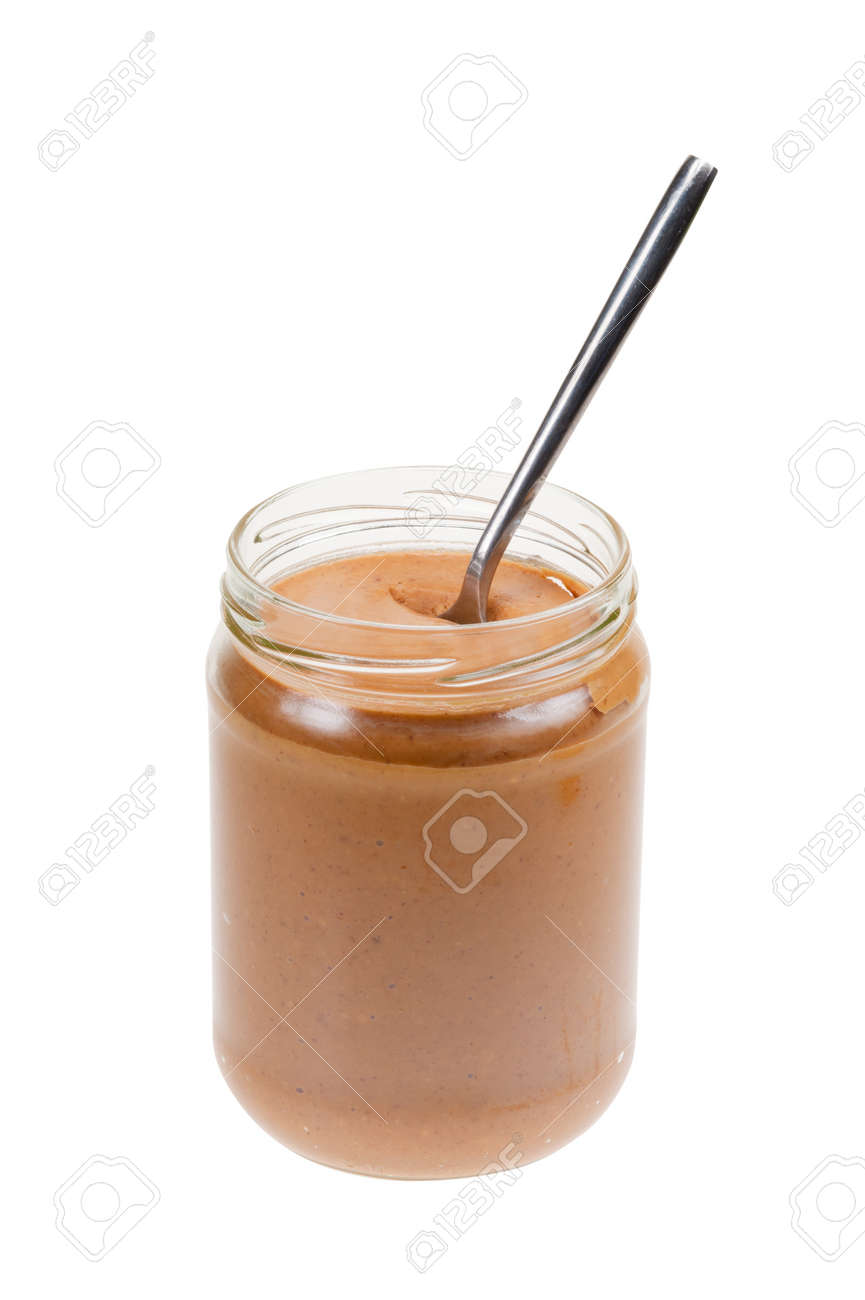 Jar of peanut butter with spoon  isolated on a white background Standard-Bild - 9107901