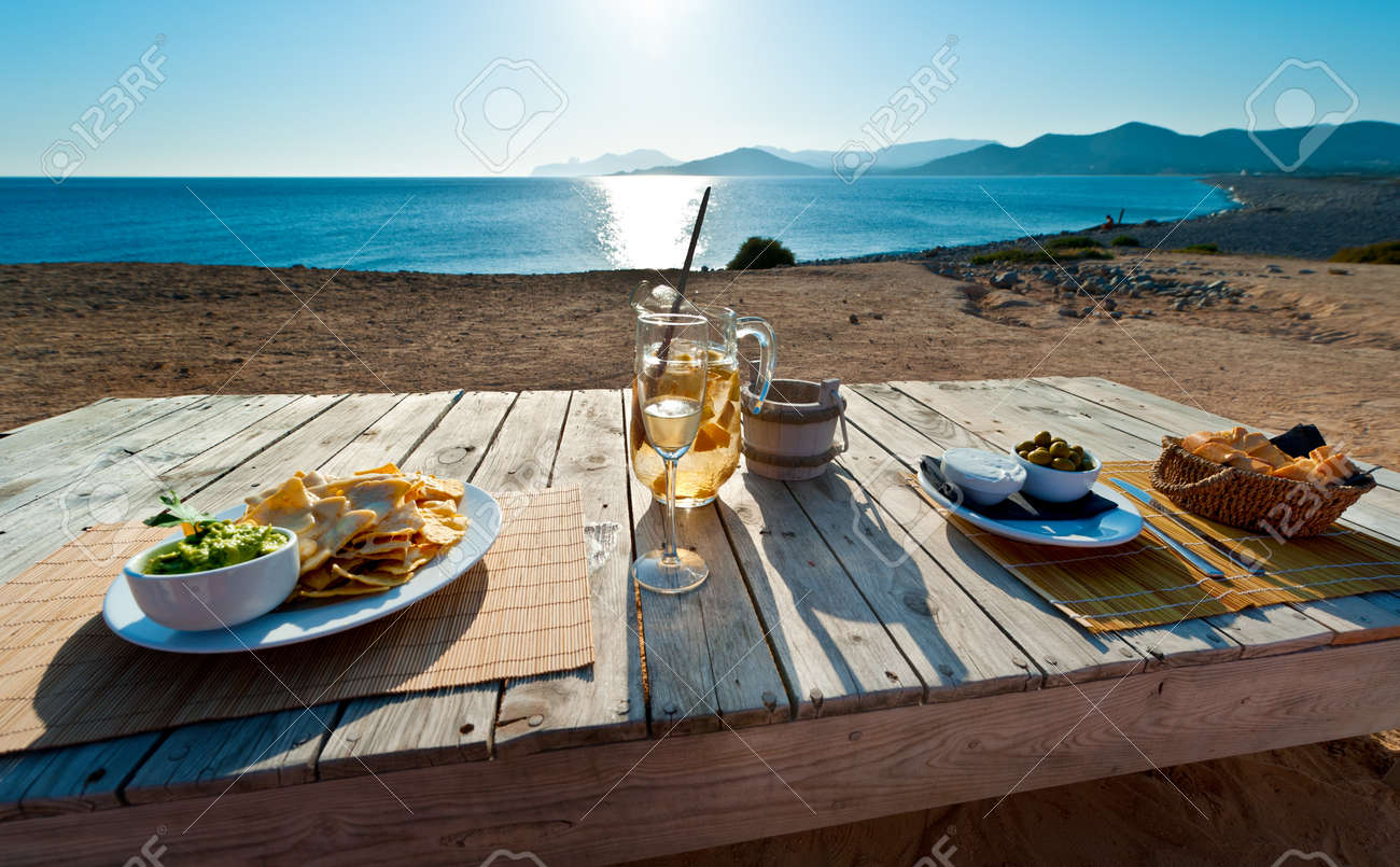 waiting for the sunset in with sangria and food in Ibiza spain Standard-Bild - 9270625