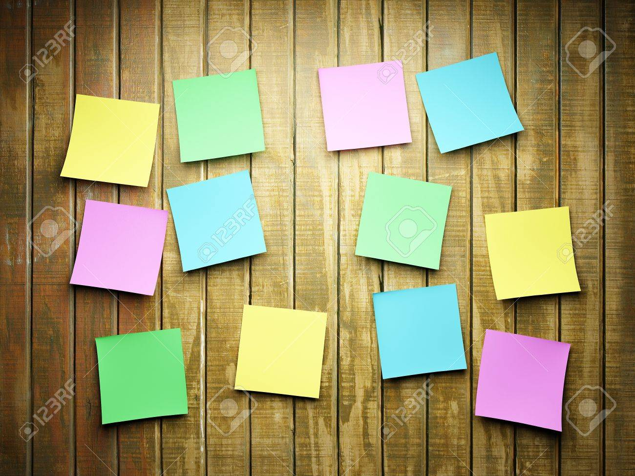Blank Sticky Notes On A Wooden Wall