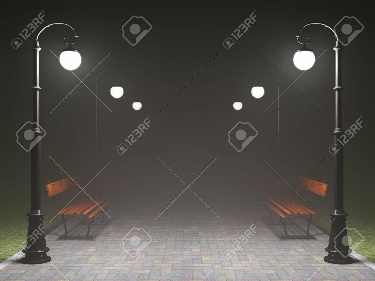 A romantic night scene. Illuminated park alley with old fashioned street light and bench Stock Photo - 12389153