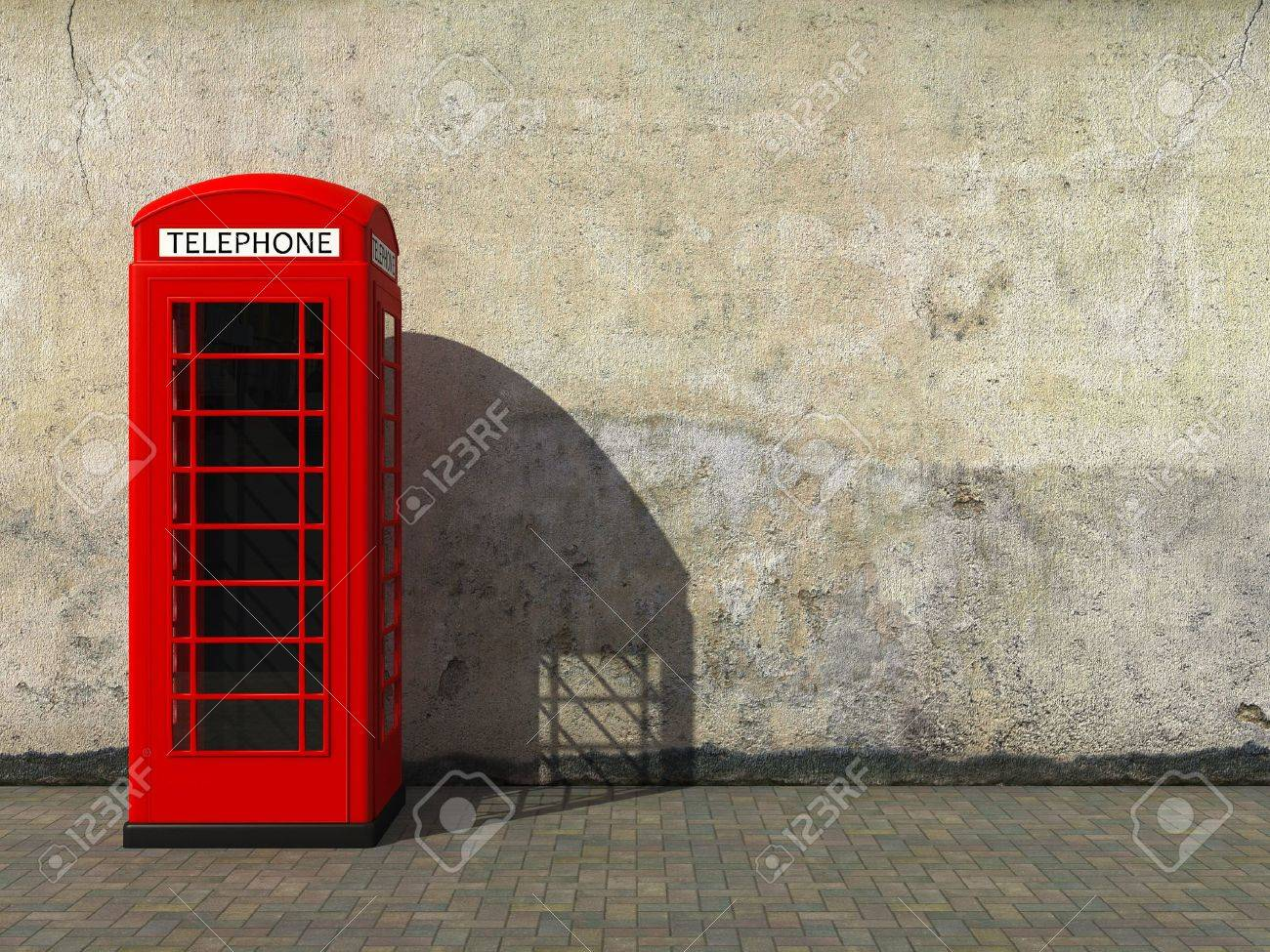 Classic red telephone booth at the dirty grunge wall Stock Photo - 13275861
