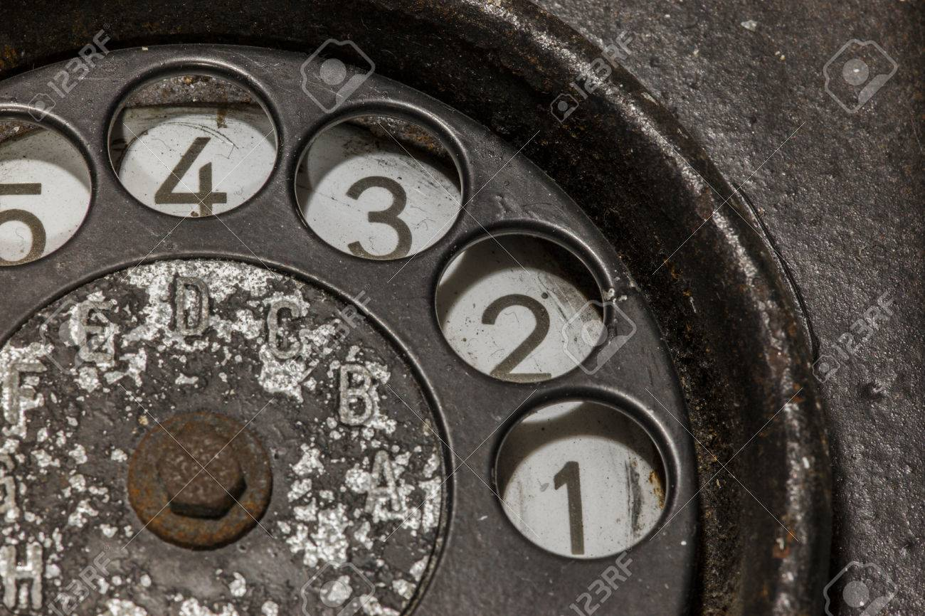 Old black telephone. Close-up of a rotary dial - 30457488