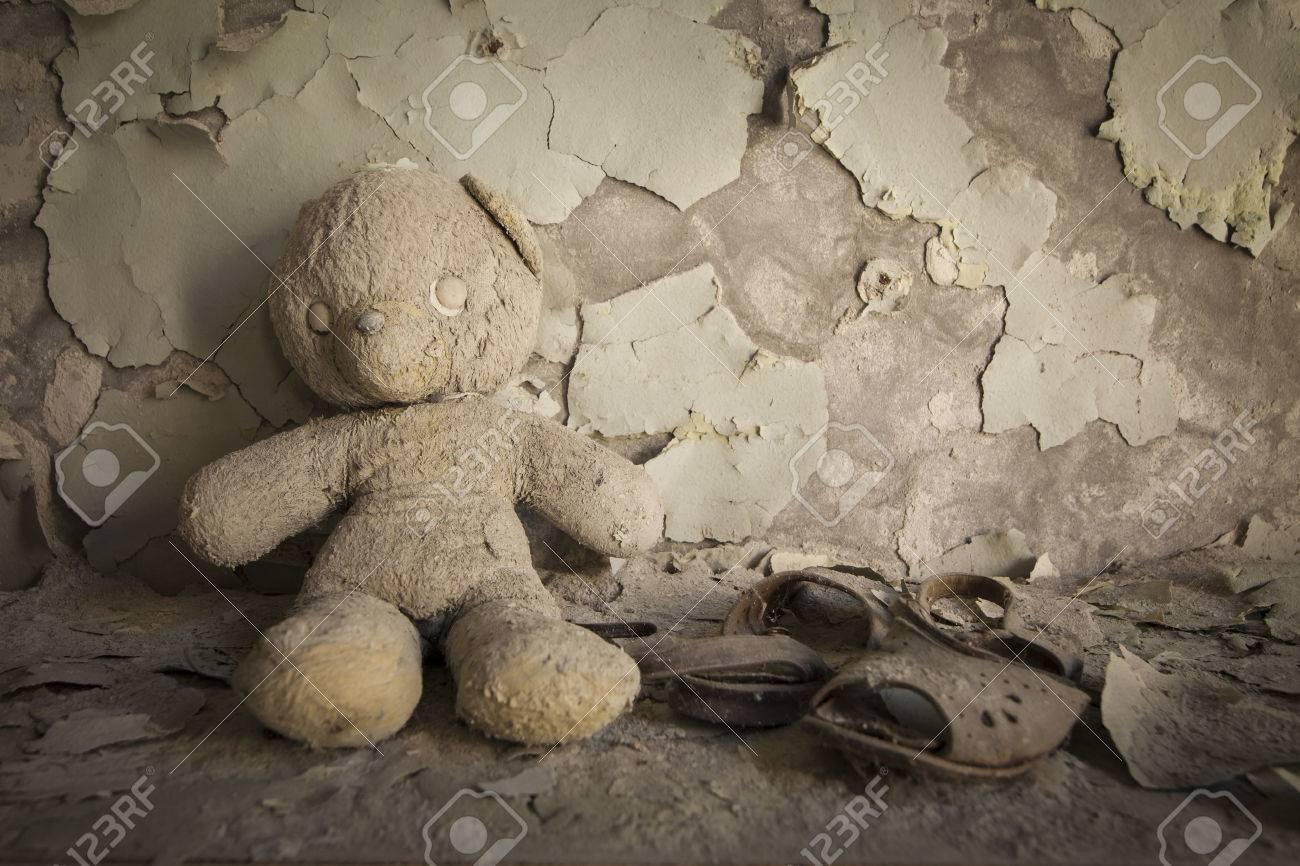 Old white teddy bear in an abandoned kindergarten in Pripyat - Chernobyl nuclear power plant zone of alienation - 43203050