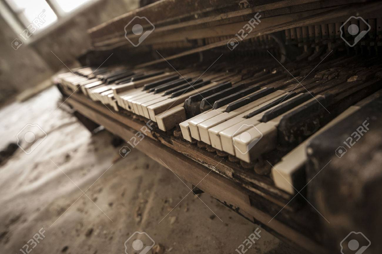 Close-up of an old piano keyboard in an abandoned auditorium in Pripyat. Chernobyl nuclear power plant zone of alienation - 43179114