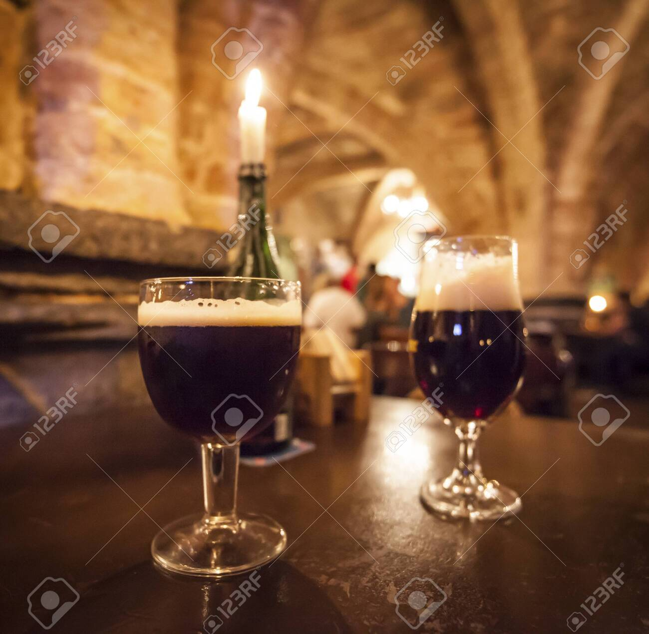 Beer glasses and a romantic candle in a typical Belgian pub - 131748845
