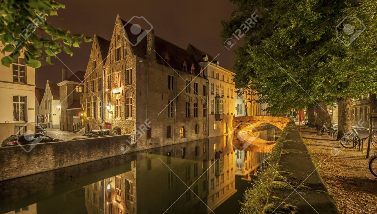 Romantic nocturnal view of a canal in Bruges. Night view of famous Bruges city view, Belgium, nightshot of Bruges canals, houses on canal - 131748616