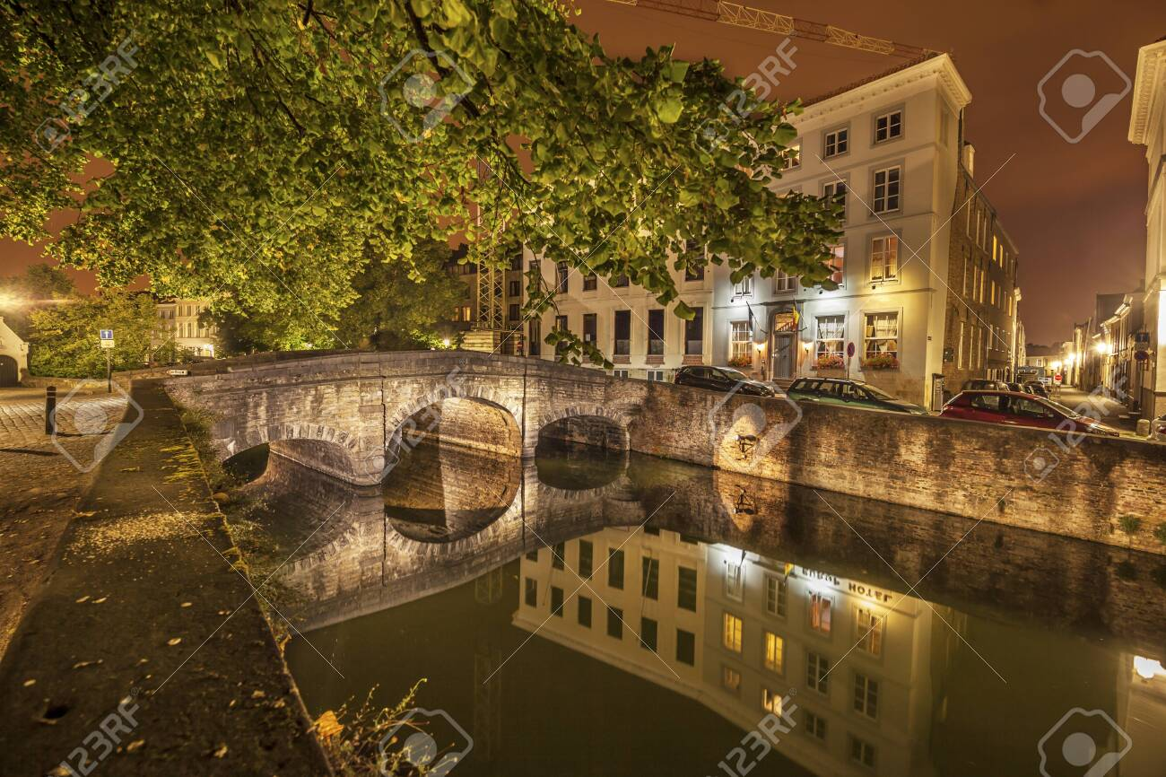 Romantic nocturnal view of a canal in Bruges. Night view of famous Bruges city view, Belgium, nightshot of Bruges canals, houses on canal - 131748915