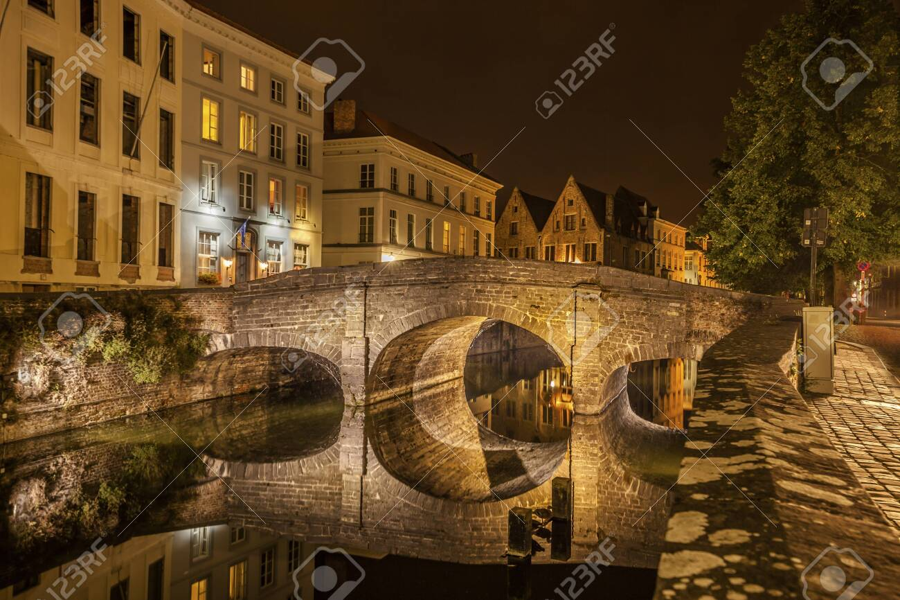 Romantic nocturnal view of a canal in Bruges. Night view of famous Bruges city view, Belgium, nightshot of Bruges canals, houses on canal - 131749186