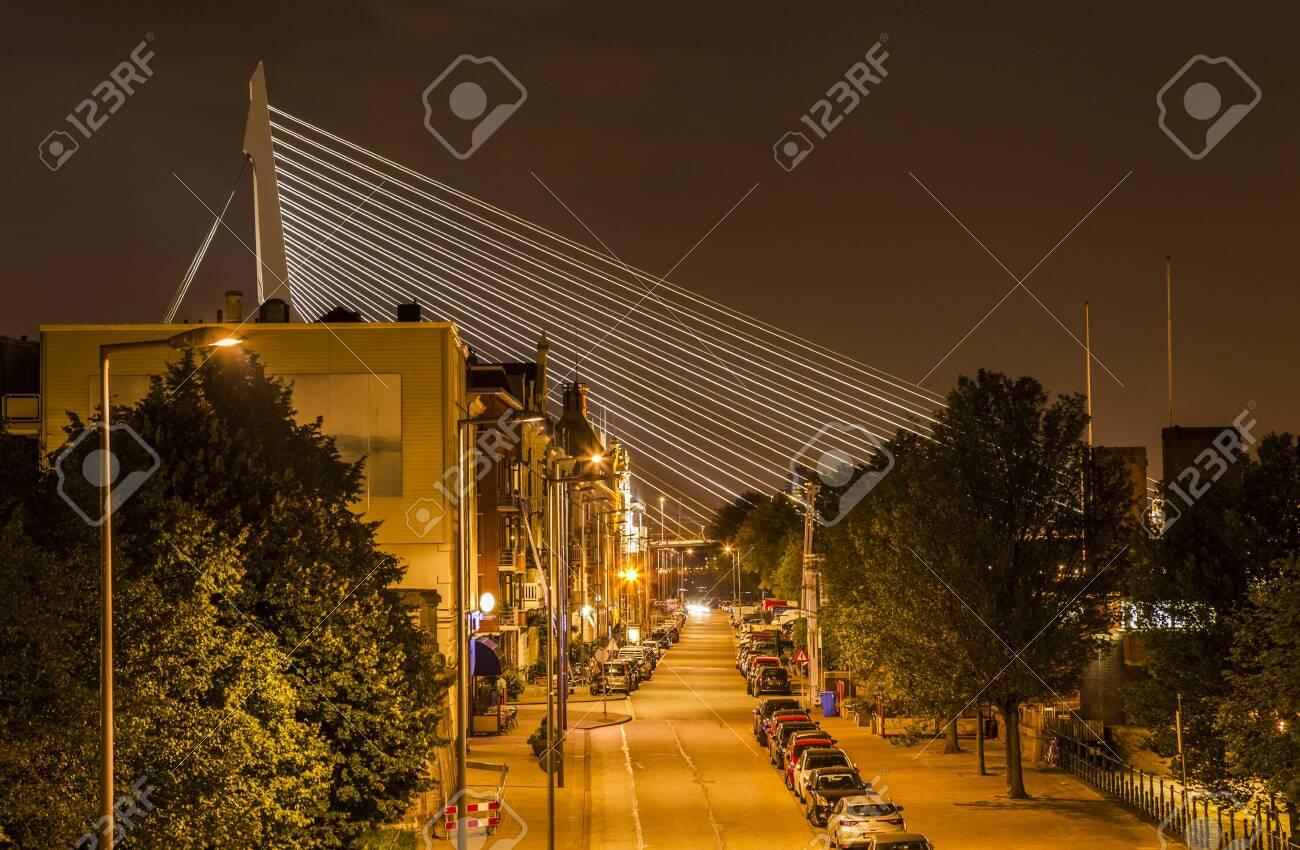A night street in Rotterdam with the Erasmus Bridge on background - 131748524