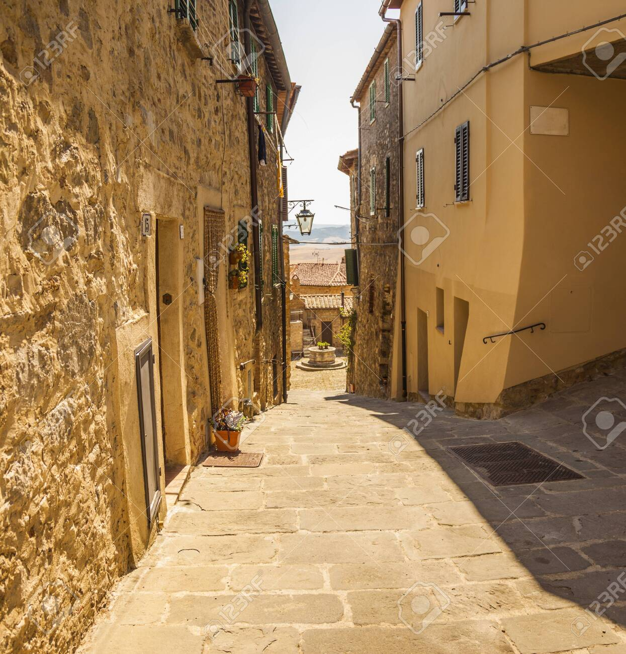 A typical small street of Castiglione d'Orcia, an ancient village in Tuscany, Italy - 136078628