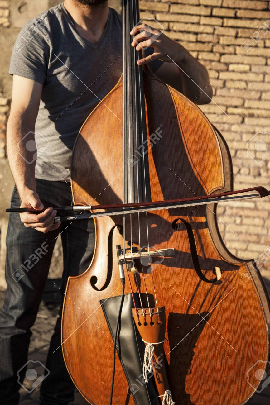 Musician playing the cello outside in a sunny day - 146507435
