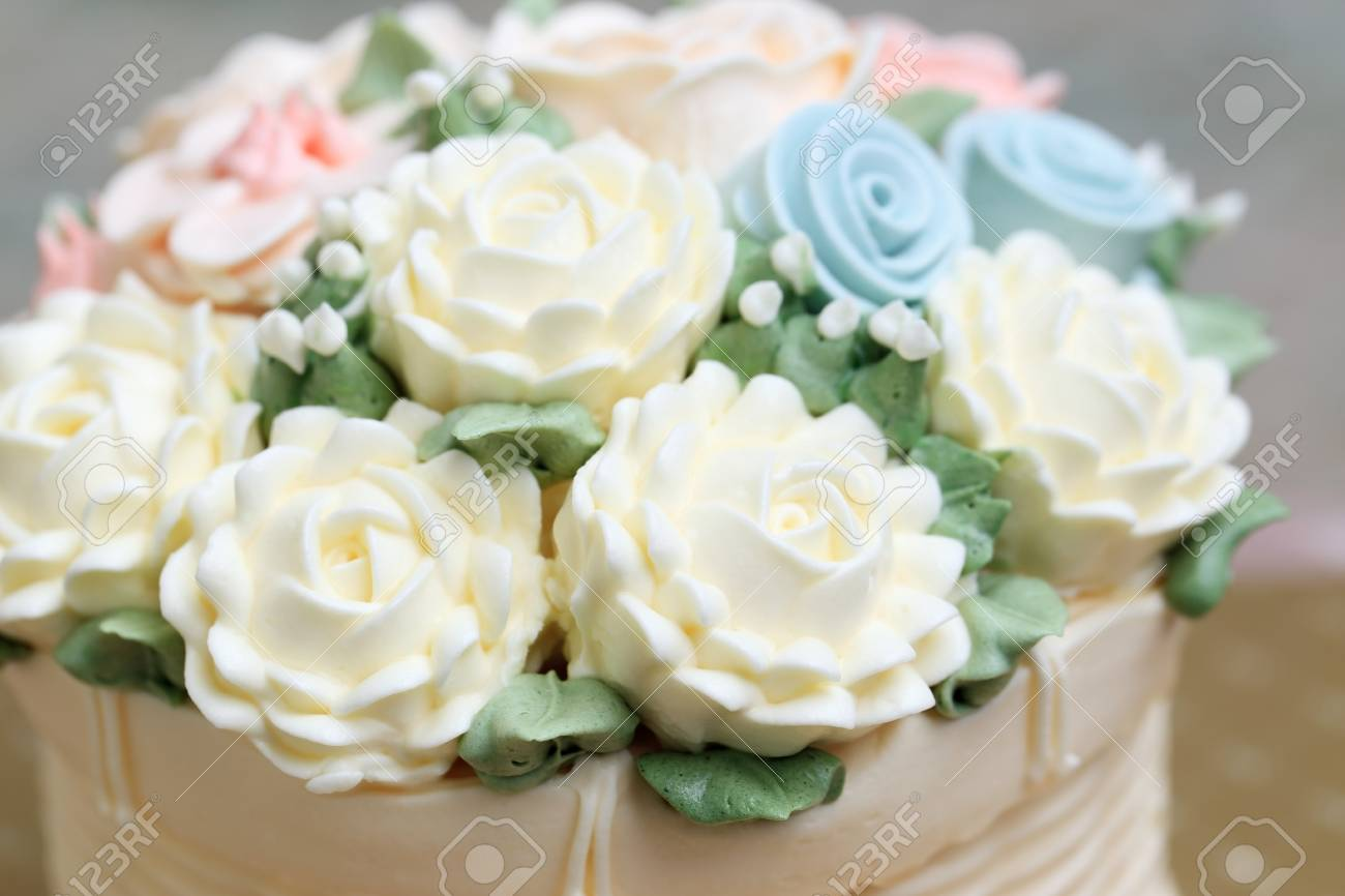 Close Up Of Wedding Or Birthday Cake Decorated White Flowers Stock