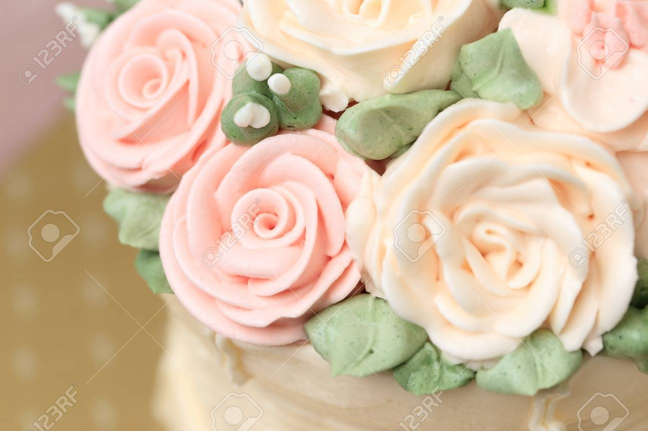 Close Up Of Wedding Or Birthday Cake Decorated With Flowers Made From Cream Selective Focus