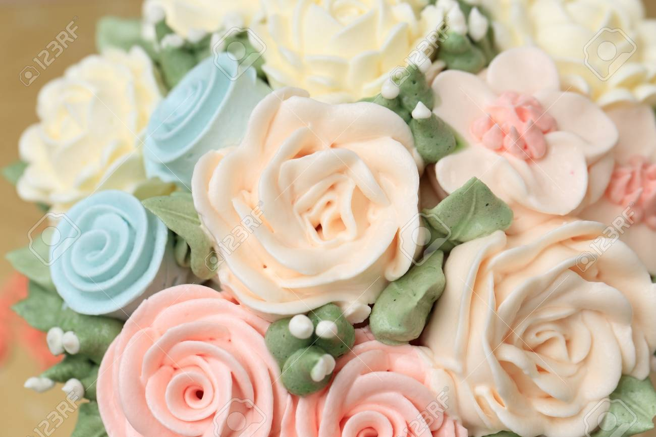 Wedding Or Birthday Cake Decorated With Flowers Made From Cream