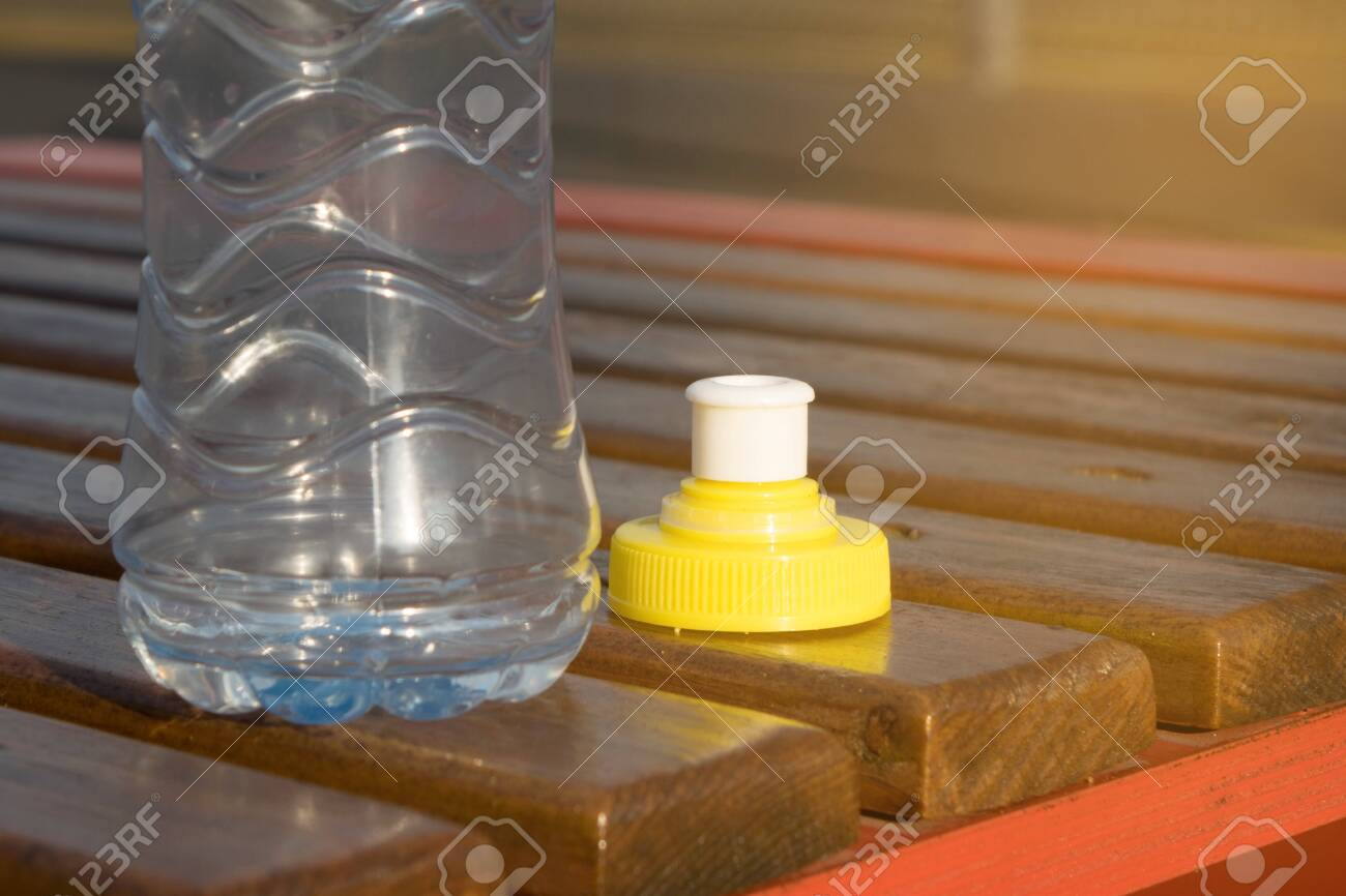 Outstanding A Bottle Of Water Standing On A Wooden Bench At The Sports Field Machost Co Dining Chair Design Ideas Machostcouk