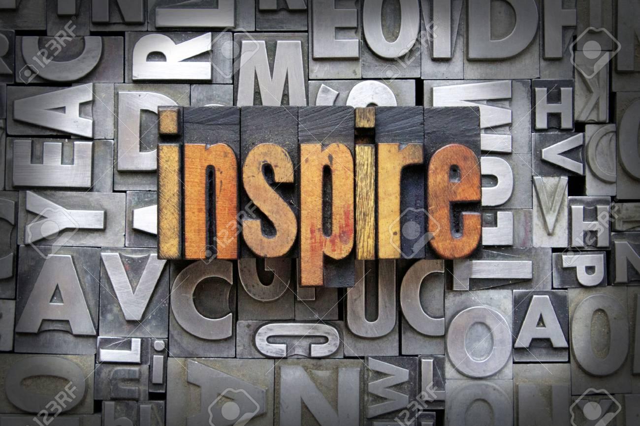 Inspire written in vintage letterpress type Stock Photo - 24898163